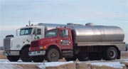 Cedar Grove milk trucks in winter